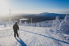 Beautiful cold mountain view of ski resort, sunny winter day wit Royalty Free Stock Photo