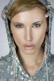 Beautiful cold winter women. Portrait of a beautiful cold winter women stock images
