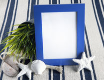 Beautiful collage with blue photo frame on old vintage rug. Stock Image