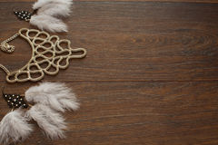 Beautiful collection of jewelry for women delicate earrings with feathers and necklace. Flat lay. The view from the top. Wooden dark background Stock Images