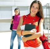 Beautiful college friends  in campus. Female college friends in campus Royalty Free Stock Photo