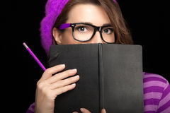 Beautiful College Girl Covering her Face with Black Notebook Royalty Free Stock Image