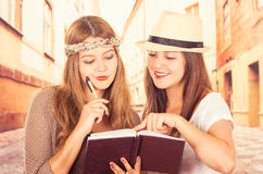 Beautiful college girls travelling Stock Photography