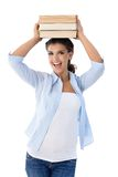 Beautiful college student holding books smiling Stock Images