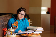 Beautiful college student in pizzeria Royalty Free Stock Image