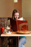 Beautiful college student in pizzeria Royalty Free Stock Photography
