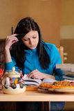 Beautiful college student in pizzeria Stock Photos