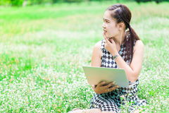 Beautiful college student relaxing in park Stock Photo