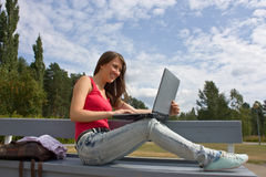 Beautiful college student working on her laptop Stock Photo