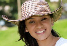The beautiful Colombian girl in a hat Royalty Free Stock Photo