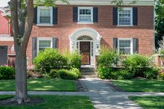 Beautiful colonial style brick home in Kenosha, WI. Kenosha, Wisconsin/USA – JULY 08 2018 - front entrance of colonial style home in affluent neighborhood stock images