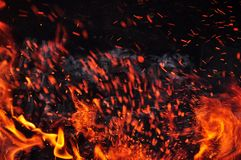 Beautiful color of burning red coals and black charred wood stock images