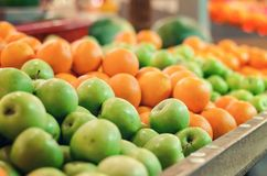 Beautiful color combination, variety of fresh raw fruits background display at market stall. Selective focus shot Royalty Free Stock Photos