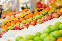 Beautiful color combination, variety of fresh raw fruits background display at market stall. Selective focus shot Stock Photo