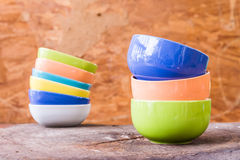 Beautiful color cups on wood background Royalty Free Stock Images