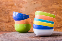 Beautiful color cups on wood background stock image