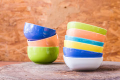 Beautiful color cups on wood background royalty free stock photo