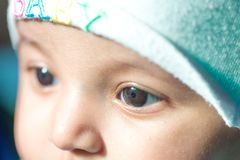 Closeup of the eye of a cute Indian baby stock images