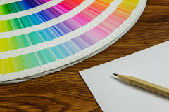 Beautiful color swatches book and pencil on table Stock Images