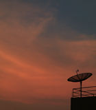 Beautiful Color of Tropical Sunset Sky with the Silhouette of Satellite Dish Stock Photos