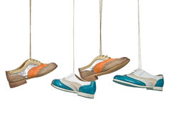 Beautiful color woman shoes hanging on laces with isolated white Royalty Free Stock Images