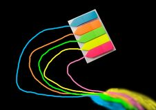 colored bookmarks that are attached to a notebook or a book, isolated on a black background stock images