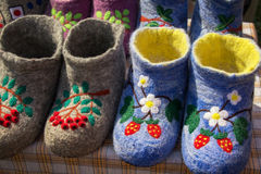 Beautiful colored embroidered Russian valenki sheep wool to wear indoors Royalty Free Stock Photos