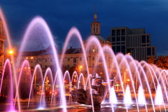 Beautiful colored fountain in the city Dnepr at night . Beautiful multi-colored fountain near the Opera House in the city Dnepr at night Dnepropetrovsk, Ukraine stock photography