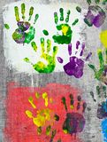 Colored hand prints on wall. Beautiful colored hand prints on wall stock image