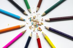 Colored pencils on a white background stock photos
