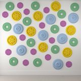 Beautiful colored rosettes on a white wall Stock Photo