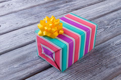Beautiful colored striped box with a gift. Christmas gift box. Happy moments. New Years surprise stock photo