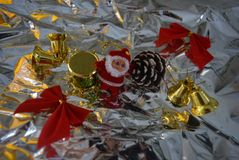 Beautiful multicolored New Year`s wrapped gifts with two red gift velvet on a silver, metallic background, crumpled paper. A beautiful colorful background stock photography
