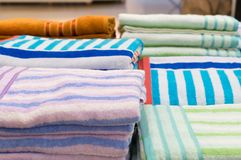 Beautiful colorful bath towels are on sale Stock Photos