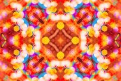 Beautiful colorful bokeh festive lights in kaleidoscope Stock Images