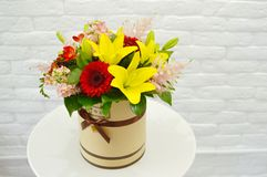 Beautiful  colorful bouquet of flowers  in a hat box stock illustration