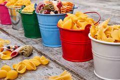 Beautiful colorful buckets with pasta. Royalty Free Stock Photography
