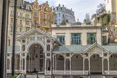 Beautiful colorful buildings, colonnade and street in Karlovy Vary Royalty Free Stock Image