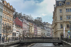 Beautiful colorful buildings next to the shore of the river in Karlovy Vary Stock Images