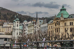 Beautiful colorful buildings next to the shore of the river in Karlovy Vary Stock Photos