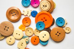 Beautiful colorful buttons on a white background. Beautiful handcraft composition. A button on a white background Royalty Free Stock Photo