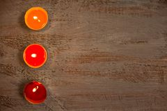 Colorful candles on the wooden boards. stock photography
