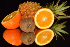 Beautiful citrus fruits close up on the mirror royalty free stock images