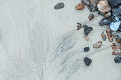Beautiful colorful landscape close up of pebbles on sandy beach Royalty Free Stock Image
