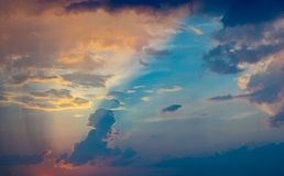 Beautiful and colorful cloudscape with sun rays stock images