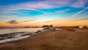 Sunrise On The Horizon At Sandy Beach, Puerto Penasco, Mexico. Beautiful, colorful, cloudy sunrise on the horizon at Sandy Beach, Puerto Penasco, Mexico Stock Photos