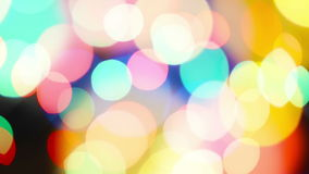 Beautiful colorful defocused bokeh festive lights as abstract holiday celebration background. stock video