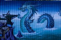 Street art dragon. Beautiful colorful drawing of street art royalty free stock photo