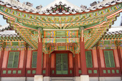 Beautiful and colorful exterior of traditional Korean building. Beautiful exterior of traditional Korean building with very colorful roof detail stock images