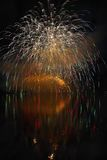Beautiful colorful fireworks on the water surface with a clean black background. Fun festival and international contest of Firefig. Hters from all over the world Stock Photos